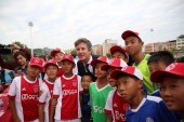 Former Dutch football play Edwin van der Sar, center, CEO of Amsterdamsche Football Club Ajax (AFC Ajax), poses for photos with young football players during the cooperation signing ceremony of R&F football club and AFC Ajax in Meizhou city, south Ch