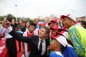 Former Dutch football play Edwin van der Sar, left, CEO of Amsterdamsche Football Club Ajax (AFC Ajax), takes selfies with young football players during the cooperation signing ceremony of R&F football club and AFC Ajax in Meizhou city, south China's
