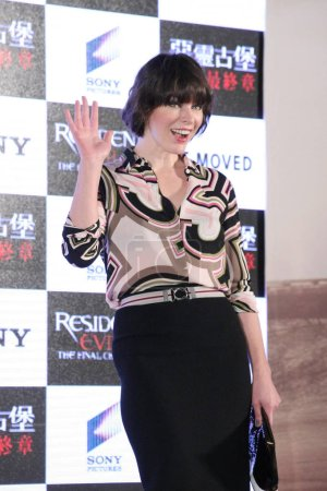 American actress Milla Jovovich waves