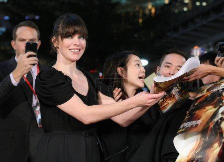 American actress Milla Jovovich signs