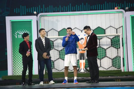 Photo for Retired Portuguese football star Luis Figo, second right, attends a gala for the Tmall 11.11 Global Shopping Festival 2017 at Mercedes-Benz Arena in Shanghai, China, 10 November 2017. - Royalty Free Image