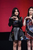 Yeri of South Korean girl group Red Velvet, left, attends a fan meeting in Taipei, Taiwan, 16 August 2017.