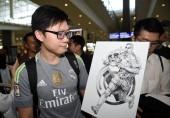 A fan shows a drawing of Brazilian football star Ronaldo Luis Nazario de Lima, commonly known as Ronaldo, to welcome him at the Hong Kong International Airport after he landed in Hong Kong, China, 23 May 2017.