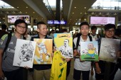 Fans show drawings and paintings of Brazilian football star Ronaldo Luis Nazario de Lima, commonly known as Ronaldo, to welcome him at the Hong Kong International Airport after he landed in Hong Kong, China, 23 May 2017.
