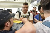 Brazilian football star Ronaldo Luis Nazario de Lima, center, commonly known as Ronaldo, signs autographs for fans at the Hong Kong International Airport after he landed in Hong Kong, China, 23 May 2017.