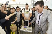 Brazilian football star Ronaldo Luis Nazario de Lima, center, commonly known as Ronaldo, is surrounded by fans at the Hong Kong International Airport after he landed in Hong Kong, China, 23 May 2017.