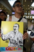 A fan shows a painting of Brazilian football star Ronaldo Luis Nazario de Lima, commonly known as Ronaldo, to welcome him at the Hong Kong International Airport after he landed in Hong Kong, China, 23 May 2017.