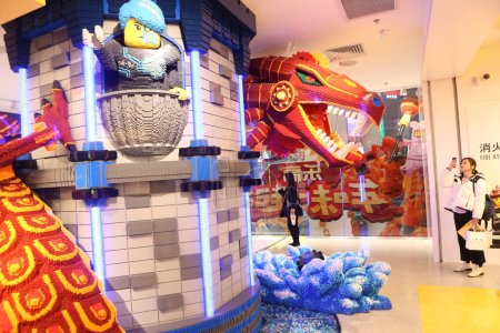 Photo for A model of a Chinese dragon spiralling up a pillar, constructed with 180,000 Lego bricks, is displayed at a shopping mall in Shanghai, China, 6 January 2019. - Royalty Free Image