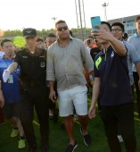 Brazilian football star Ronaldo Luis Nazario de Lima, center, commonly known as Ronaldo, visits one of his soccer schools in Shanghai, China, 28 May 2017.