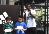 French football player Paul Pogba of English Premier League soccer club Manchester United, right, poses with young fans during a promotional event for Adidas Tango League in Hong Kong, China, 19 June 2017.