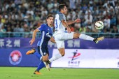 Italian football player Eder, right, of Inter Milan kicks the ball to make a pass against French football player Benjamin Stambouli of FC Schalke 04 during the 2017 Changzhou Dragon City Cup International Football Invitation Tournament in Changzhou c