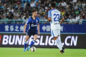 Algerian football player Nabil Bentaleb, left, of FC Schalke 04 kicks the ball to make a pass against Italian football player Eder of Inter Milan during the 2017 Changzhou Dragon City Cup International Football Invitation Tournament in Changzhou city