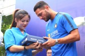 Italian football player Danilo D'Ambrosio, right, of Inter Milan is pictured during a fan meeting in Nanjing city, east China's Jiangsu province, 22 July 2017.