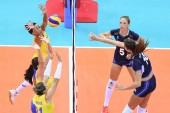Cristina Chirichella of Italy, right front, spikes against Brazil in their final match of the FIVB Volleyball World Grand Prix Finals 2017 in Nanjing city, east China's Jiangsu province, 6 August 2017