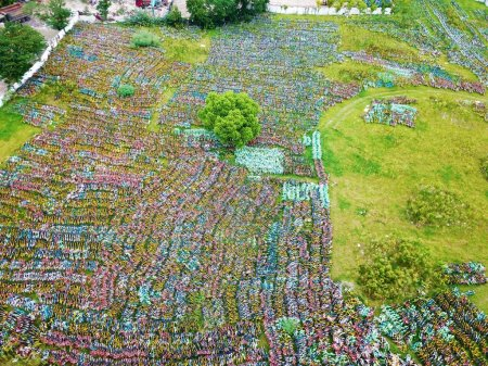 Bicycles of bike-sharing service are lined up at a...