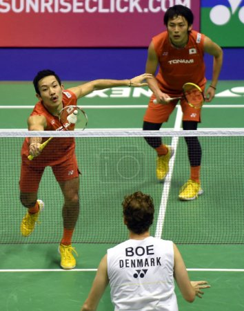Photo for Keigo Sonoda, left, and Takeshi Kamura of Japan compete against Mathias Boe and Carsten Mogensen of Denmark in their men's doubles final match during the Hong Kong Open 2016 badminton tournament in Hong Kong, China, 27 November 2016 - Royalty Free Image