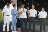 Retired Argentine football star Javier Zanetti, center, speaks next to Erick Thohir, right, founder and chairman of Mahaka Group and also President and Owner of Inter Milan Football Club, and other guests during the