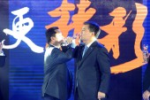 Zhang Jindong, right, Chairman of Chinese retail giant Suning Commerce Group Co., Ltd., and Indonesian businessman Erick Thohir, president and majority owner of Italian football team Inter Milan, drink at the press conference to announce that Suning