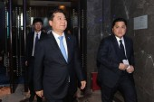 Zhang Jindong, left, Chairman of Chinese retail giant Suning Commerce Group Co., Ltd., and Indonesian businessman Erick Thohir, president and majority owner of Italian football team Inter Milan, arrive at the press conference to announce that Suning
