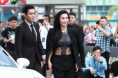Hong Kong actress Cecilia Cheung, right, and singer and actor Choi Seung-hyun, better known by his stage name T.O.P, of South Korean boy band Bigbang (Big Bang), arrive at a press conference for their new movie