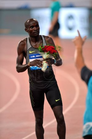 Photo for Ferguson Cheruiyot Rotich of Kenya poses with a bouquet of flowers after winning the men's 800m during the IAAF Diamond League Shanghai 2016 in Shanghai, China, 14 May 2016 - Royalty Free Image