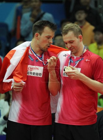 Photo for Badminton players of Denmark celebrate during the award ceremony after defeating Indonesia to win the BWF Thomas Cup 2016 in Kunshan city, east China's Jiangsu province, 21 May 2016 - Royalty Free Image