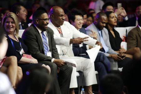 American boxer Mike Tyson, third left, and Chinese...