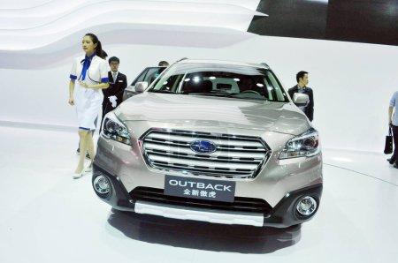 Visitors look at a Subaru