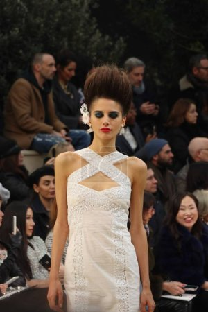 Photo for A model displays a new creation at the Chanel fashion show during the Paris Haute Couture Fashion Week Spring/Summer 2016 in Paris, France, 26 January 2016. - Royalty Free Image