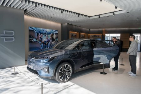 Photo for Visitors try out a M-Byte Concept EV (electric vehicle) of Byton at China's first store or an experience center of EV startup Byton, called Byton Place, in Shanghai, China, 23 January 2019 - Royalty Free Image