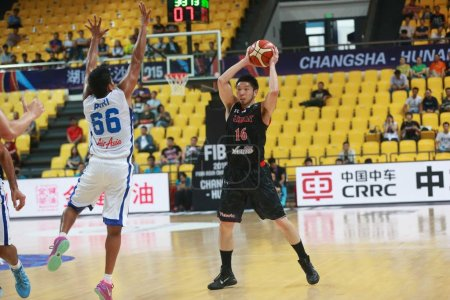 Photo for Akilan Pari of India, left, challenges Keijuro Matsui of Japan in a group match during the 2015 FIBA Asia Champions for Men in Changsha city, central China's Hubei province, 25 September 2015 - Royalty Free Image