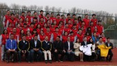 Brazilian football star Ronaldo Luis Nazario de Lima, front fifth left, poses with Michael Yu Minhong, front center, founder and CEO of New Oriental Education & Technology Group, and coaching staff at Ronaldo Academy-New Oriental Football School in B