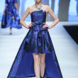 A model displays a new creation at the PLD fashion...
