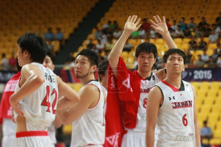 Photo for Players of Japan celebrate after defeating Malaysia in a group match during the 2015 FIBA Asia Champions for Men in Changsha city, central China's Hubei province, 24 September 2015 - Royalty Free Image