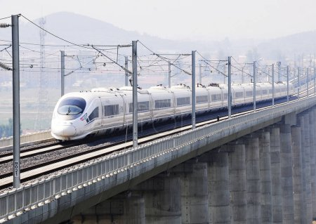 Photo for --FILE--A CRH (China Railway High-speed) bullet train travels on the Qingrong (Qingdao-Rongcheng) Intercity Railway in Yantai city, east China's Shandong province, 30 June 2015 - Royalty Free Image