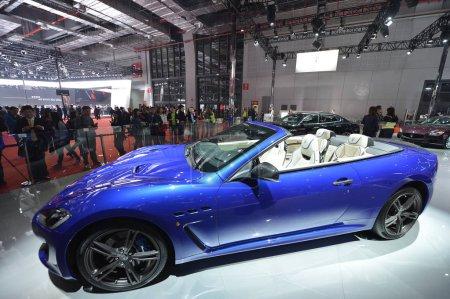 A Maserati GranCabrio is on