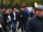 Brazilian football star Ronaldo Luis Nazario de Lima, center, talks with Michael Yu Minhong, third left, founder and CEO of New Oriental Education & Technology Group, as he arrives at Ronaldo Academy-New Oriental Football School in Beijing, China, 17