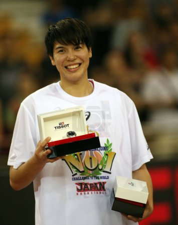 Photo for Ramu Tokashiki of Japan poses with her trophy of MVP after defeating China in the final match during the 2015 FIBA Asia Championship for Women in Wuhan city, central China's Hubei province, 5 September 2015 - Royalty Free Image
