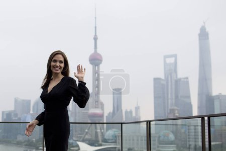 American actress Angelina Jolie waves
