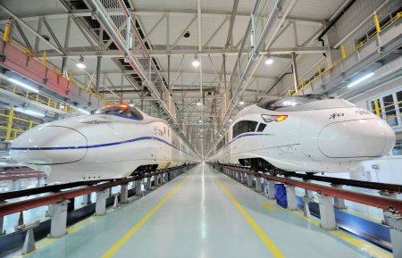 Photo for Two CRH (China Railway High-speed) bullet trains are pictured at a maintenance station in Nanjing city, east Chinas Jiangsu province, 14 January 2014 - Royalty Free Image