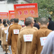 Chinese Buddhist monks take part in the firefighti...