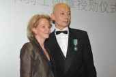 Chinese actor Ge You, right, poses with Frederique Bredin, President of CNC (Centre National du Cinema et de limage animee or the National Center of Cinematography and the moving image), after being awarded Chevalier dans lOrdre des Arts et des Lettr