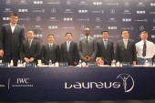 Retired Chinese basketball superstar Yao Ming, left, Former American track and field athlete Edwin Moses, fourth right, Chairman of the Laureus World Sports Academy, Russian gymnast Alexey Nemov, right, and other guests pose during a press conference