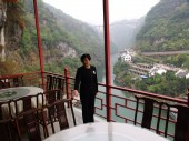 A Chinese waitress poses in the Fangweng hanging restaurant on the cliff of the Happy Valley of Xiling Gorge in Yichang city, central Chinas Hubei province, 2 April 2013.