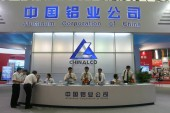 People visit the stand of Chinalco (Aluminum Corporation of China), parent company of Chalco (Aluminum Corporation of China Limited), during an exhibition in Shanghai, China, 1 July 2009