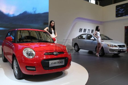 Models pose with Lifan 330