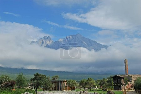 Photo for Landscape of the Jade Dragon Snow Mountain (Yulong Snow Mountain) at Old Town of Lijiang in Lijiang city, southwest Chinas Yunnan province, 29 June 2012. - Royalty Free Image