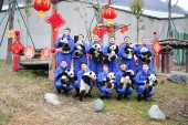 Giant panda cubs born in 2018 held by keepers pose for photos during an event to pay a New Year call to celebrate the upcoming Chinese Lunar New Year, also known as Spring Festival, at the Shenshuping breeding base of Wolong National Nature Reserve i