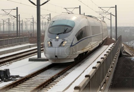 Photo for A CRH (China Railway High-speed) bullet train travels on the Beijing-Guangzhou High-speed Railway in China, 22 December 2012. - Royalty Free Image