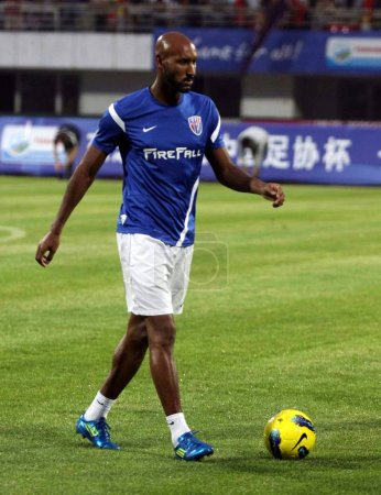 Photo for Nicolas Anelka of Shanghai Shenhua warms up with teammates before their Chinese FA Cup match against Changchun Yatai in Changchun city, northeast Chinas Jilin province, 18 July 2012 - Royalty Free Image